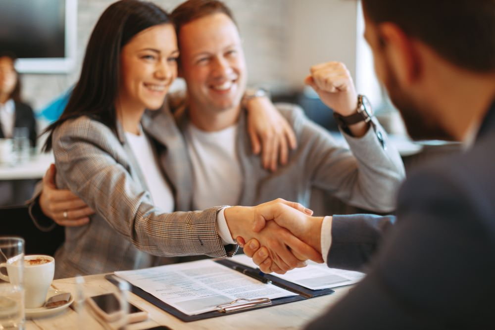 couple happy to know your value proposition as a financial advisor